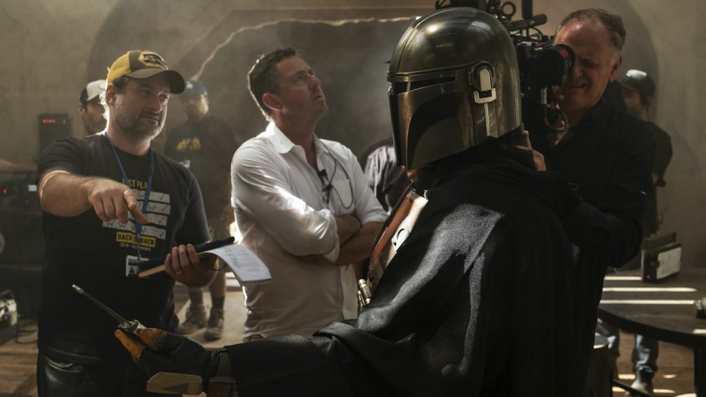 Dave Filoni, Greig Frazer and Baz Idoine on the set of THE MANDALORIAN, eclusively on Disney+