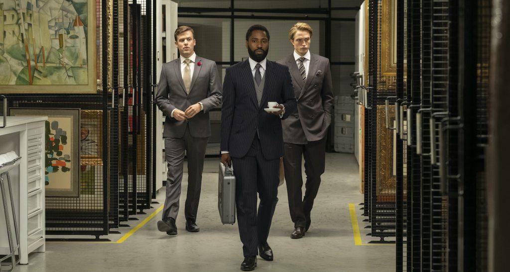 Caption: (L-r) JACK CUTMORE-SCOTT, JOHN DAVID WASHINGTON and ROBERT PATTINSON in Warner Bros. Pictures' action epic