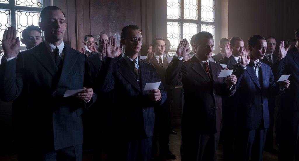 Twelve good men and true:  a dozen background cast, who work in repeat performance throughout the season, take the oath as the trial's jury members. Courtesy Merrick Morton/HBO