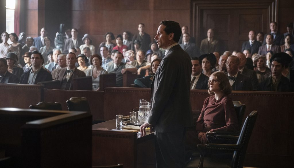 Perry Mason (Matthew Rhys) addresses the jury, as his client, Emily Dodson (Gayle Rankin) watches, along with additional primary cast in front rows and 200 background.  With numerous Courtroom day shoots, background actors, who appear in each scene, find plentiful employment on series with consistent repeat background requirements