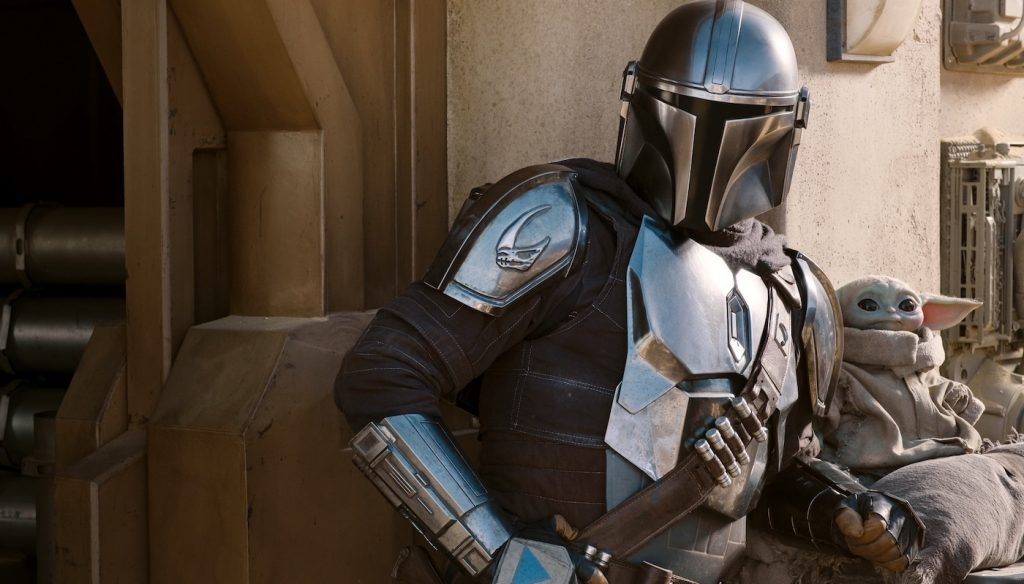The Mandalorian (Pedro Pascal) and the Child in The Mandalorian, season two. Courtesy Lucasfilm.