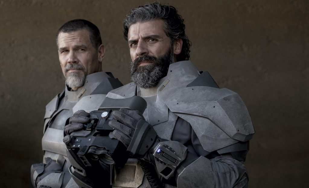 "Caption: (L-r) JOSH BROLIN as Gurney Halleck and OSCAR ISAAC as Duke Leto Atreides in Warner Bros. Pictures' and Legendary Pictures' action adventure ""DUNE,"" a Warner Bros. Pictures and Legendary release. Photo Credit: Chiabella James"