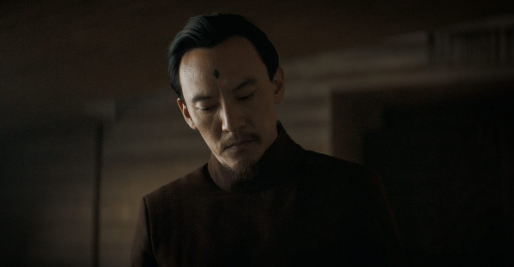 "Caption: CHANG CHEN as Dr. Yueh in Warner Bros. Pictures' and Legendary Pictures' action adventure ""DUNE,"" a Warner Bros. Pictures and Legendary release. Photo Credit: Courtesy of Warner Bros. Pictures and Legendary Pictures"