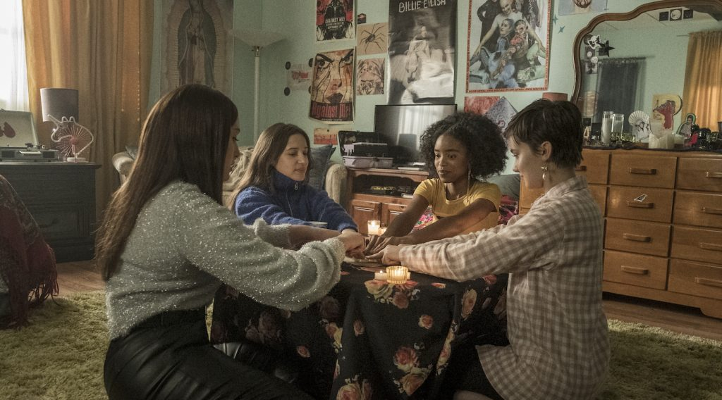 (l-r) Lourdes (Zoey Luna) Frankie (Gideon Adlon) Tabby (Lovie Simone) and Lily (Cailee Spaeny) perform rituals and talk about being cautious with their gifts in Columbia Pictures' THE CRAFT: LEGACY. Photo by Rafy Photography.