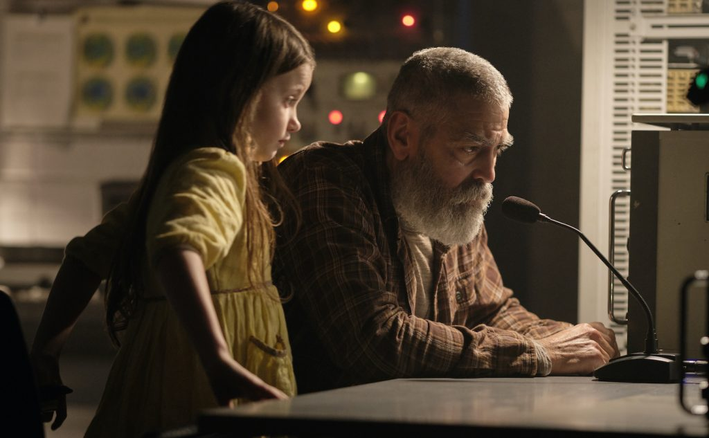 Caoilinn Springall as Iris and George Clooney as Augustine. Cr. Philippe Antonello/NETFLIX ©2020