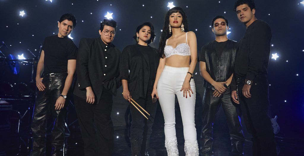 SELENA THE SERIES (L to R) CARLOS ALFREDO JR. as JOE OJEDAand  HUNTER REESE PENA as RICKY VELA and NOEMI GONZALEZ as SUZETTE QUINTANILLA and CHRISTIAN SERRATOS as SELENA QUINTANILLA and GABRIEL CHAVARRIA as A.B QUINTANILLA and JESSE POSEY as CHRIS PEREZ in Trailer of SELENA THE SERIES Cr. Michael Lavine/NETFLIX © 2020