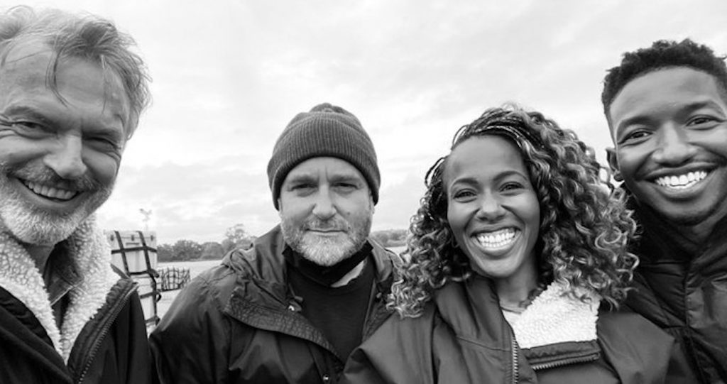 L-r: Sam Neill, Colin Trevorrow, DeWanda Wise, and Mamoudou Athie on set. Courtesy Universal Pictures.