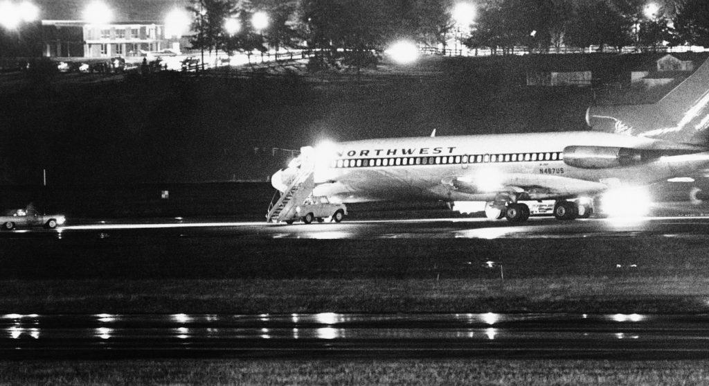 A hijacked Northwest Airlines jetliner 727 sits on a runway for refueling at Tacoma International Airport, Nov. 25, 1971, Seattle, Wash. (AP Photo)