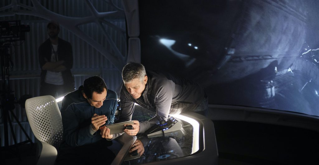 THE MIDNIGHT SKY (2020): Demian Bichir and Director George Clooney on the set of The Midnight Sky. Cr. Philippe Antonello/NETFLIX