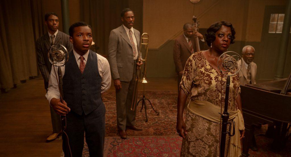 "Ma Rainey's Black Bottom (2020): (L to R) Chadwick Boseman (""Levee""), Dusan Brown (""Sylvester""), Colman Domingo (""Cutler""), Michael Potts (""Slow Drag""), Viola Davis (""Ma Rainey""), Glynn Turman (""Toldeo"") Cr. David Lee / Netflix"