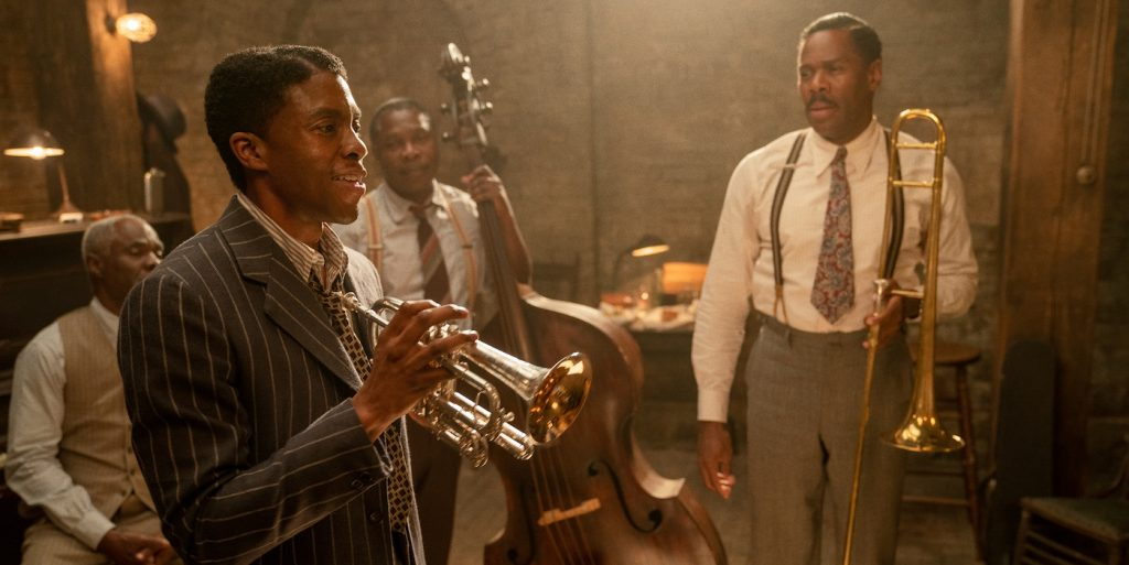 Ma Rainey's Black Bottom (2020): (L to R) Glynn Turman as Toldeo, Chadwick Boseman as Levee, Michael Potts as Slow Drag, and Colman Domingo as Cutler. Cr. David Lee / Netflix