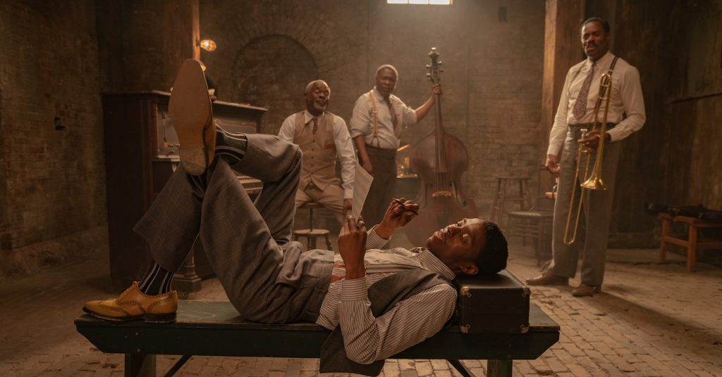 Ma Rainey's Black Bottom (2020): (L to R) Chadwick Boseman as Levee, Glynn Turman as Toldeo, Michael Potts as Slow Drag, Colman Domingo as Cutler. Cr. David Lee / Netflix