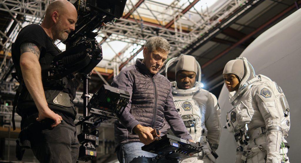 THE MIDNIGHT SKY (2020) Director George Clooney on set at Shepperton Studios with David Oyelowo and Tiffany Boone on the set of The Midnight Sky. Cr. Philippe Antonello/NETFLIX ©2020