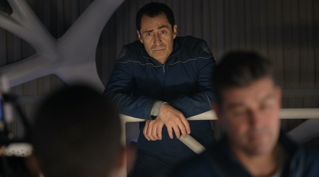 THE MIDNIGHT SKY (2020): Demian Bichir as Sanchez and Kyle Chandler as Mitchell. Cr. Philippe Antonello/NETFLIX
