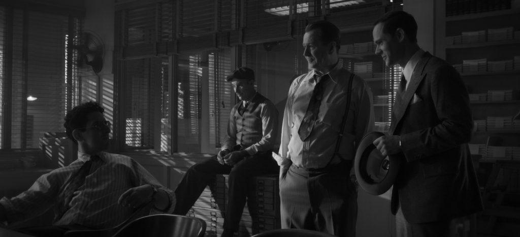 MANK (2020). Gary Oldman as Herman Mankiewicz and Tom Pelphrey as Joe Mankiewicz. Courtesy NETFLIX