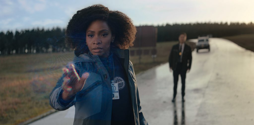 L-R: Teyonah Parris as Monica Rambeau and Randall Park as Jimmy Woo in Marvel Studios' WANDAVISION. Courtesy Marvel Studios.