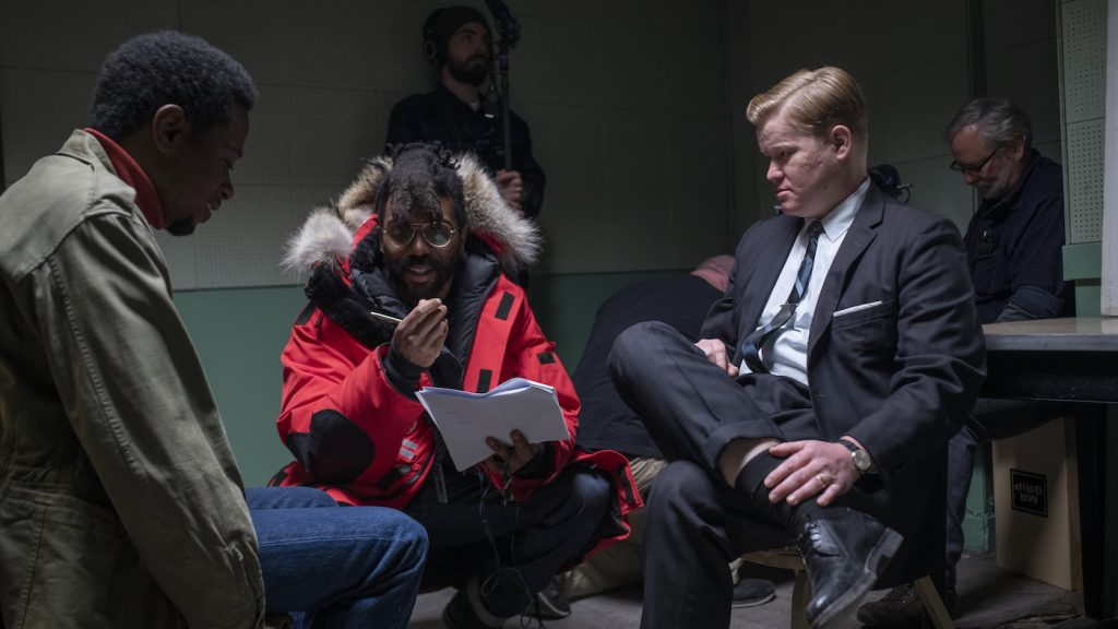 """Caption: (L-r) LAKEITH STANFIELD, director SHAKA KING and JESSE PLEMONS on the set of Warner Bros. Pictures' """"JUDAS AND THE BLACK MESSIAH,"""" a Warner Bros. Pictures release. Photo Credit: Glen Wilson"""