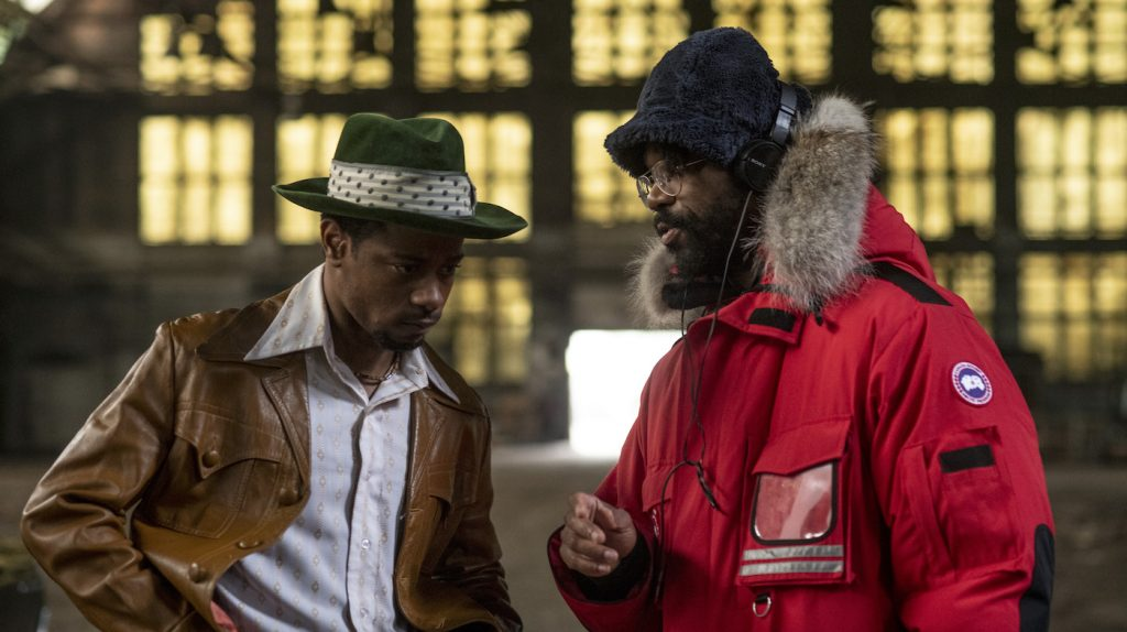 """Caption: (L-r) LAKEITH STANFIELD and director SHAKA KING on the set of Warner Bros. Pictures' """"JUDAS AND THE BLACK MESSIAH,"""" a Warner Bros. Pictures release. Photo Credit: Glen Wilson"""