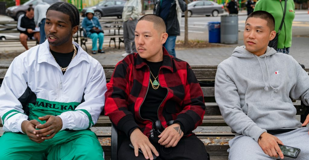 (l-r.) Actor Pop Smoke, director Eddie Huang and actor Taylor Takahashi on the set of their film BOOGIE, a Focus Features release. Credit: Nicole Rivelli / Focus Features