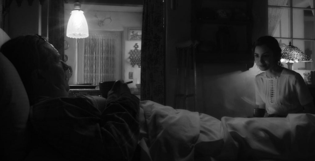 Nighttime scene in the bungalow set with Mank and his assistant, Rita (Lily Collins), one of several in which Messerschmidt applied a theatrical fadeout. (Photo: © 2020 Netflix, Inc.)