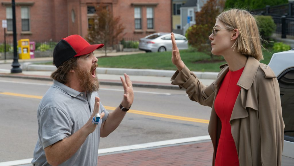 "I Care A Lot: (L to R) Macon Blair as ""Feldstrom"" and Rosamund Pike as ""Martha"". Photo Cr. Seacia Pavao / Netflix"