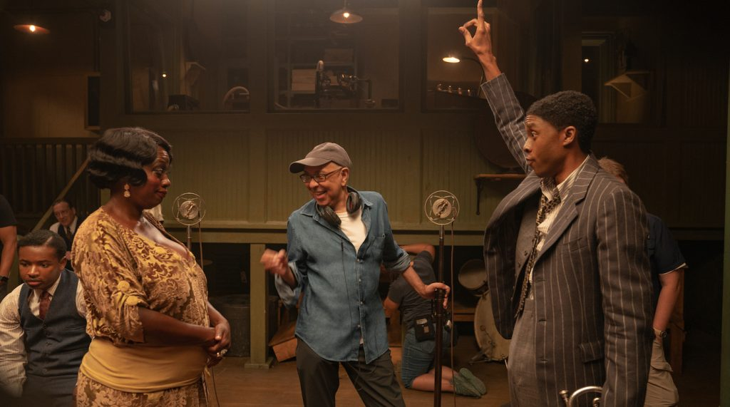 Ma Rainey's Black Bottom (2020): (L to R) Viola Davis as Ma Rainey, Director George C. Wolfe, and Chadwick Boseman as Levee. Cr. David Lee / Netflix