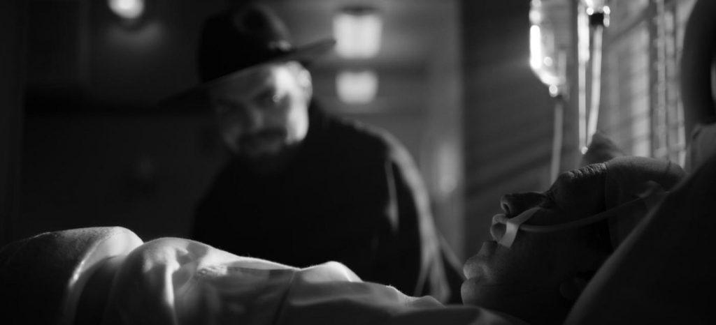 Actor Tom Burke, as Orson Welles, prepares to lean into focus, courtesy of a swing/tilt lens system. (Photo: © 2020 Netflix, Inc.