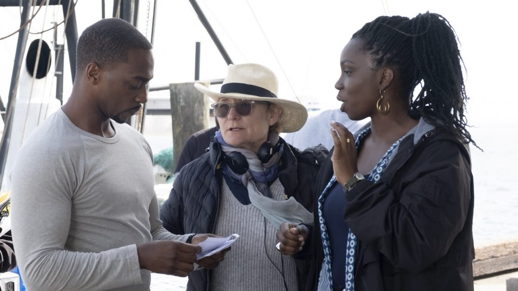L-r: Falcon/Sam Wilson (Anthony Mackie), director Kari Skogland, and Sarah Wilson (Adepero Oduye) on the set of Marvel Studios' The Falcon and the Winter Soldier.' Photo by Chuck Zlotnick. Courtesy Marvel Studios.