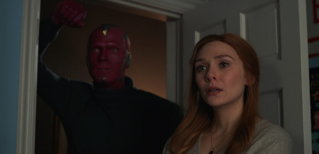 (L-r): Paul Bettany as Vision and Elizabeth Olsen as Wanda Maximoff in Marvel Studios' WandaVision, exclusively on Disney+. Photo courtesy of Marvel Studios.