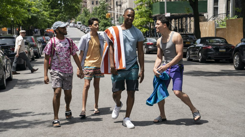 """Caption: (L -r) NOAH CATALA as Graffiti Pete, GREGORY DIAZ IV as Sonny, COREY HAWKINS as Benny and ANTHONY RAMOS as Usnavi in Warner Bros. Pictures' """"IN THE HEIGHTS,"""" a Warner Bros. Pictures release. Photo Credit: Macall Polay"""
