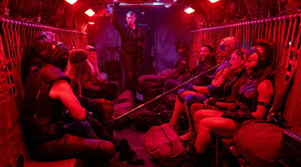 """Caption: (L-r) NATHAN FILLION as T.D.K., PETE DAVIDSON as Blackguard, SEAN GUNN as Weasel, MICHAEL ROOKER as Savant, JOEL KINNAMAN as Rich Flag, JAI COURTNEY as Boomerang, FLULA BORG as Javelin, MARGOT ROBBIE as Harley Quinn and MAYLING NG as Mongal in Warner Bros. Pictures' action adventure """"THE SUICIDE SQUAD,"""" a Warner Bros. Pictures release. Photo Credit: Jessica Miglio/™ & © DC Comics"""