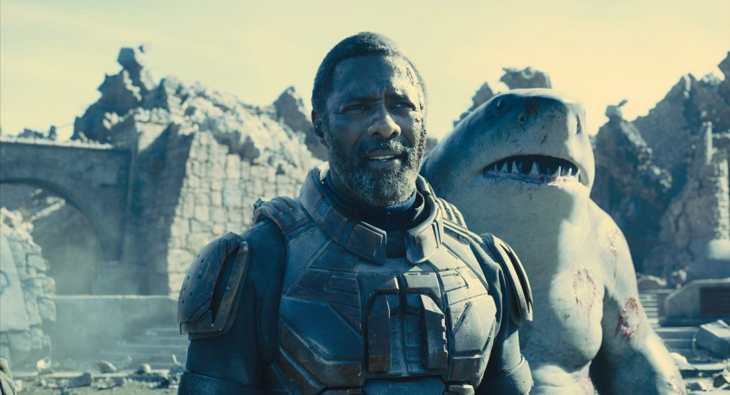 """Caption: (L-r) IDRIS ELBA as Bloodsport and KING SHARK in Warner Bros. Pictures' superhero action adventure """"THE SUICIDE SQUAD,"""" a Warner Bros. Pictures release. Photo Credit: Warner Bros. Pictures/™ & © DC Comics"""
