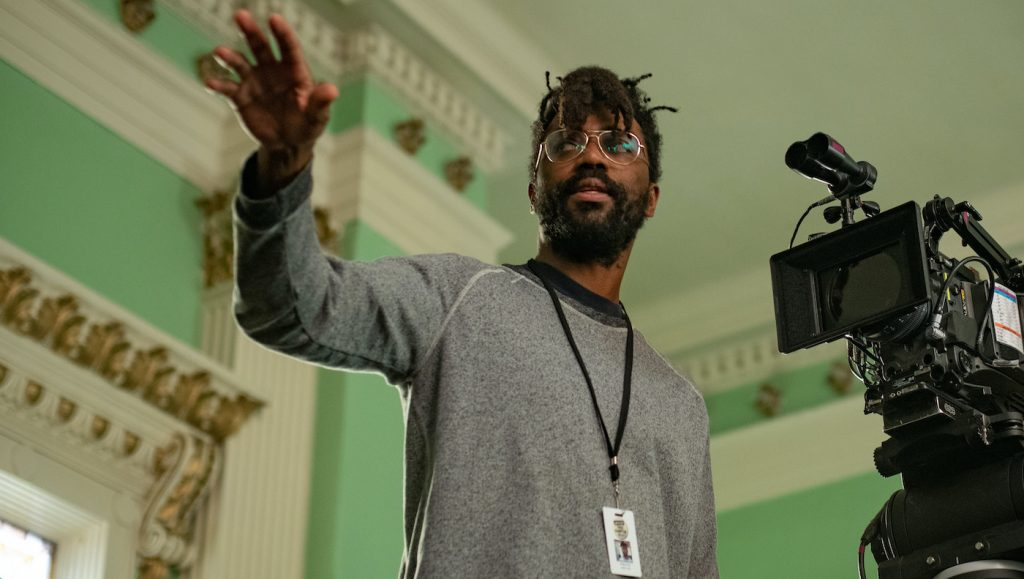 "Caption: Director SHAKA KING on the set of Warner Bros. Pictures' ""JUDAS AND THE BLACK MESSIAH,"" a Warner Bros. Pictures release. Photo Credit: Glen Wilso"
