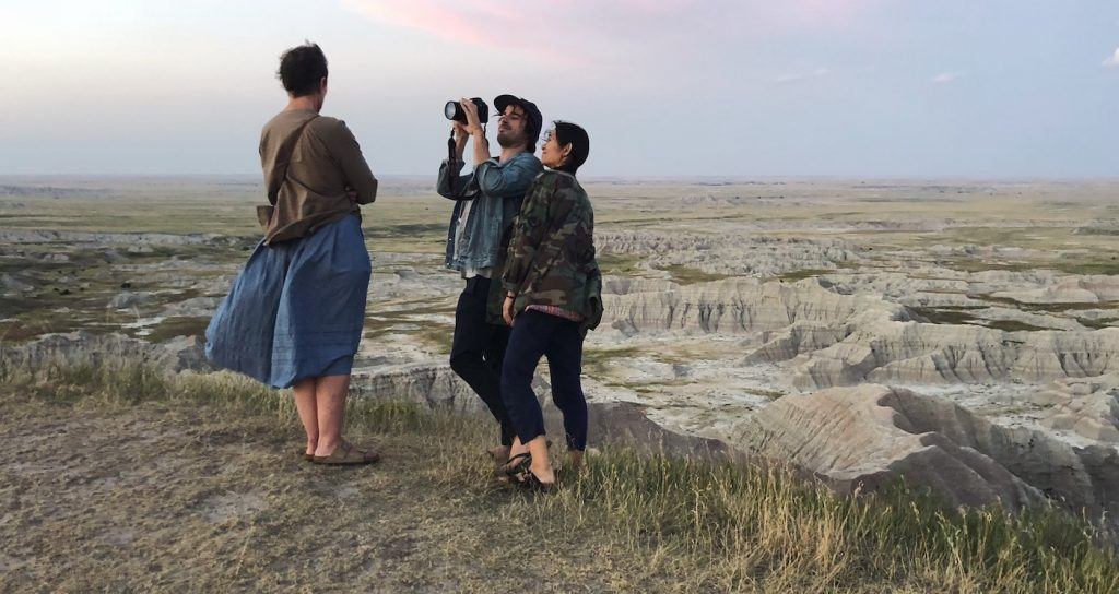 (From L-R): Frances McDormand, Cinematographer Joshua James Richards and Director/Writer/Editor/Producer Chloé Zhao on the set of NOMADLAND. Photo Courtesy of Searchlight Pictures © 2020 20th Century Studios All Rights Reserved