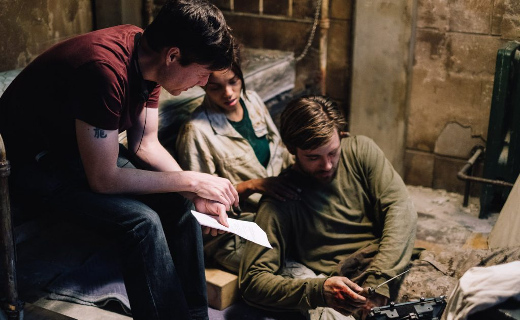 Director, Jonathan W. Stokes, Georgina Campbell as Khadija Young, and Luke Benward as Luke White behind the scenes of the thriller WILDCAT, a Saban Films release. Photo courtesy of Saban Films.