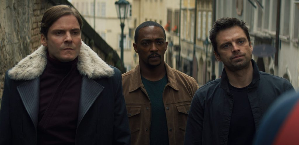 (L-R): Zemo (Daniel Brühl), Falcon/Sam Wilson (Anthony Mackie) and Winter Soldier/Bucky Barnes (Sebastian Stan) in Marvel Studios' THE FALCON AND THE WINTER SOLDIER exclusively on Disney+. Photo courtesy of Marvel Studios. ©Marvel Studios 2021. All Rights Reserved.