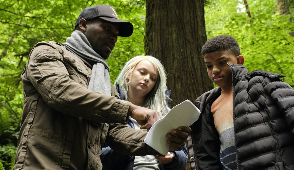 (L-R) A behind the scenes still of director David Oyelowo, Amiah Miller and Lonnie Chavis from the adventure/drama film, THE WATER MAN, an RLJE films release. Photo courtesy of Karen Ballard.