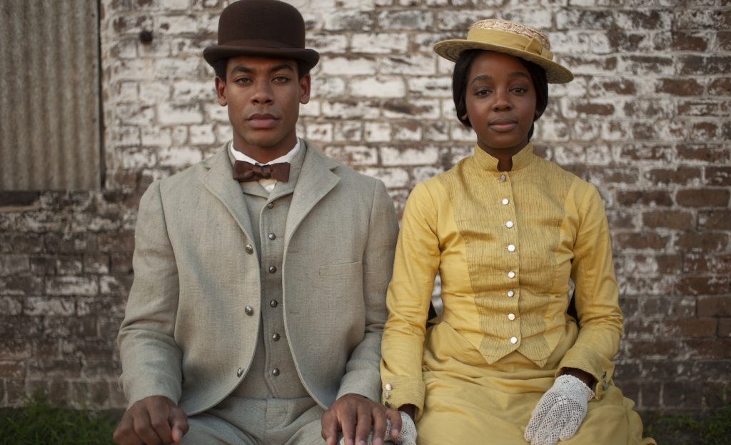 """L-r: Aaron Pierre is Caesar/Christian, and Thuso Mbedu is Cora Randall in """"The Underground Railroad."""" Photo by Kyle Kaplan. Courtesy Amazon Studios."""