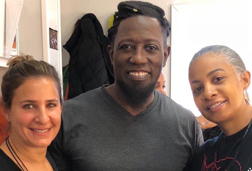 Hair department Vera Steimberg, Wesley Snipes, and hair department head Stacey Morris.