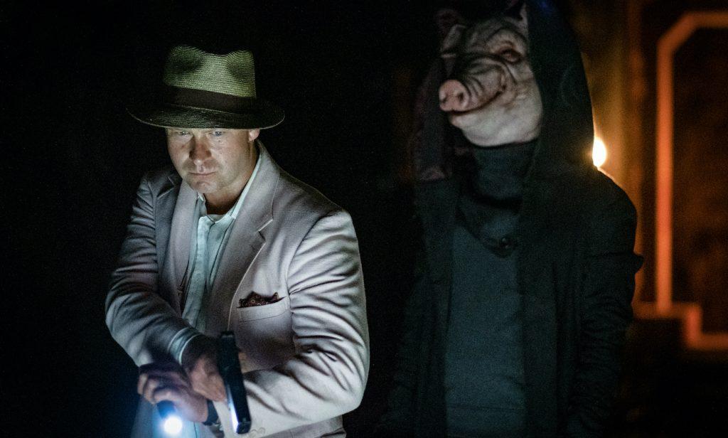 "Daniel Petronijevic stars as Detective Boz in ""Spiral."" Photo by Brooke Palmer. Courtesy Lionsgate."