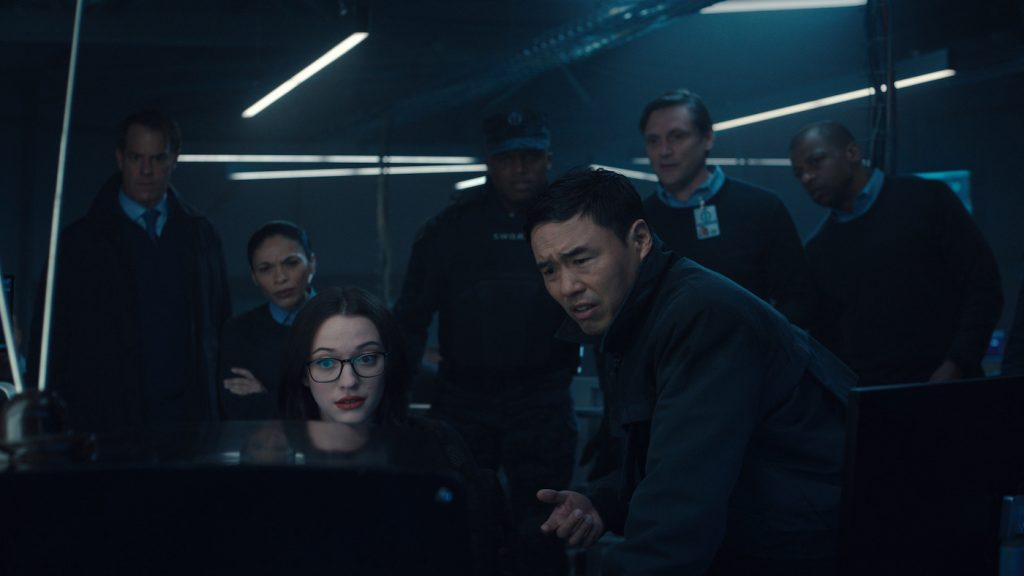 L-r: Kat Dennings as Darcy Lewis and Randall Park as Jimmy Woo in Marvel Studios' Wandavision. Photo courtesy of Marvel Studios.