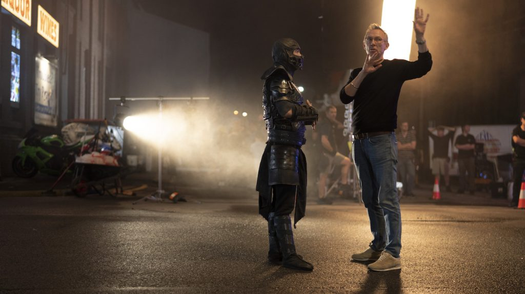 """Caption: (L-r) JOE TASLIM and director/producer SIMON MCQUOID on the set of New Line Cinema's action adventure """"Mortal Kombat,"""" a Warner Bros. Pictures release. Photo Credit: Mark Rogers"""
