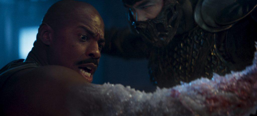 "Caption: (L-r) MEHCAD BROOKS as Major Jackson ""Jax"" Briggs and JOE TASLIM as Sub-Zero/Bi-Han in New Line Cinema's action adventure ""Mortal Kombat,"" a Warner Bros. Pictures release. Photo Credit: Courtesy Warner Bros. Pictures"