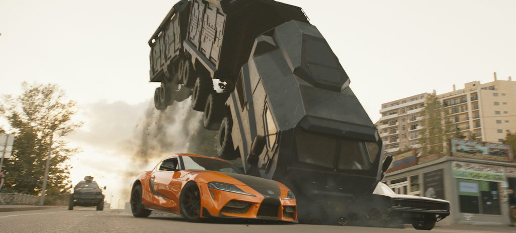 Han's Toyota Supra (left) and Dom's Dodge Charger (right) attempt to stop the monstrous three-section armored vehicle dubbed the Armadillo in F9, co-written and directed by Justin Lin.