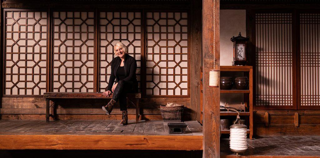 "Kalina Ivanov on the set of the Hanok built for episode 6, ""Meet Me In Daegu."" Courtesy Kalina Ivanov/HBO."