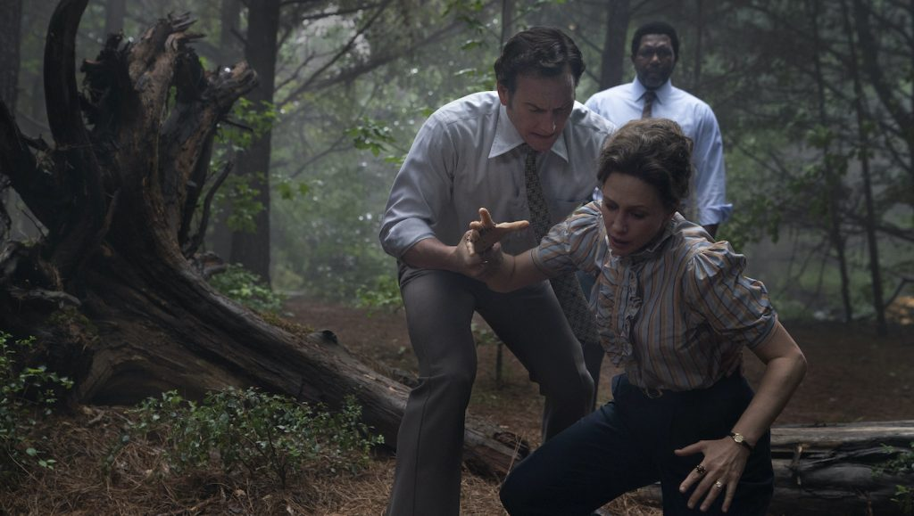 """Caption: (L-r) VERA FARMIGA as Lorraine Warren, PATRICK WILSON as Ed Warren and KEITH ARTHUR BOLDEN as Sgt. Clay in New Line Cinema's horror film """"THE CONJURING: THE DEVIL MADE ME DO IT,"""" a Warner Bros. Pictures release. Photo Credit: Ben Rothstein"""