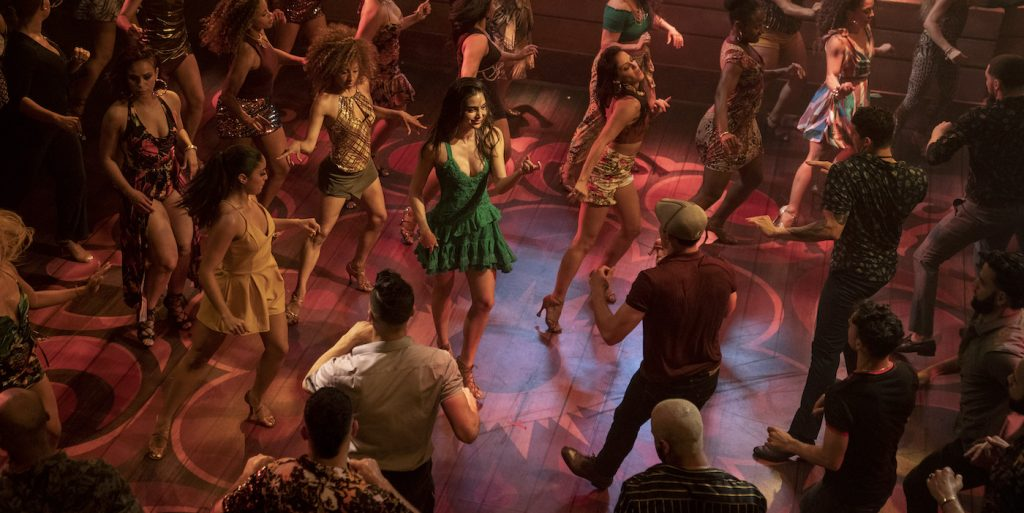 """Caption: MELISSA BARRERA (center) as Vanessa in Warner Bros. Pictures' """"IN THE HEIGHTS,"""" a Warner Bros. Pictures release. Photo Credit: Macall Polay"""