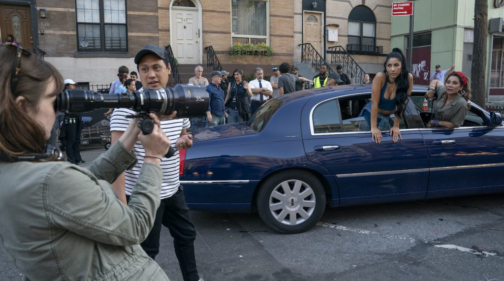 """Caption: (L-r) DP ALICE BROOKS (foreground), director JON M. CHU, STEPHANIE BEATRIZ and DAPHNE RUBIN-VEGA on the set of Warner Bros. Pictures' """"IN THE HEIGHTS,"""" a Warner Bros. Pictures release. Photo Credit: Macall Polay"""
