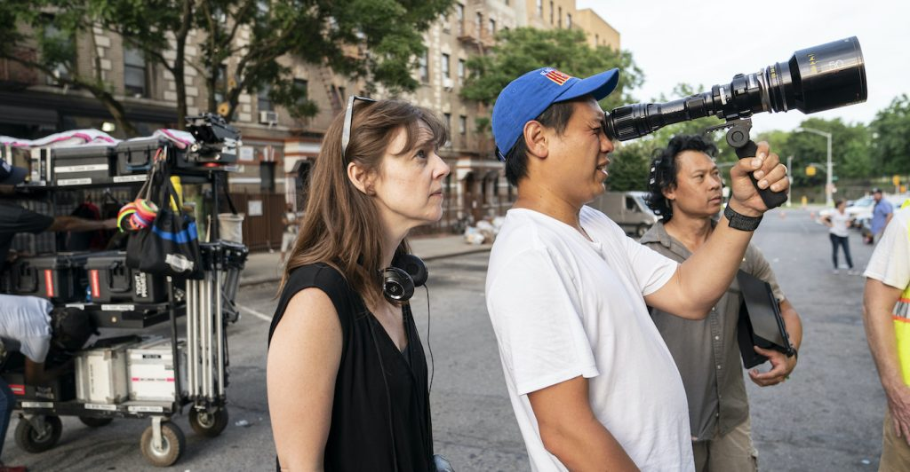 """Caption: (L-r) Director of photography ALICE BROOKS and director JON M. CHU on the set of Warner Bros. Pictures' """"IN THE HEIGHTS,"""" a Warner Bros. Pictures release. Photo Credit: Macall Polay"""