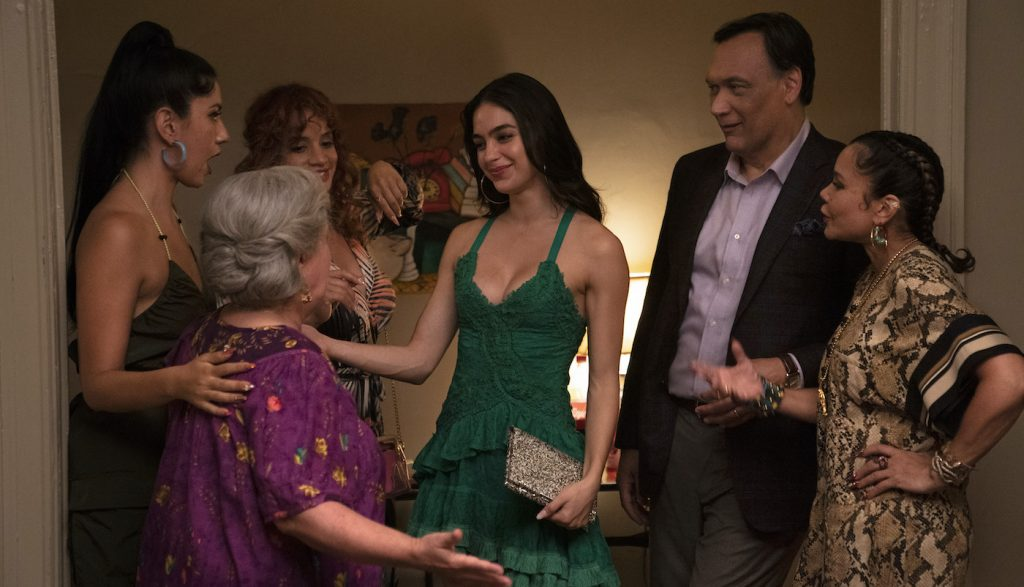 """Caption: (L-r) STEPHANIE BEATRIZ as Carla, OLGA MEREDIZ as Abuela Claudia, DASCHA POLANCO as Cuca, MELISSA BARRERA as Vanessa, JIMMY SMITS as Kevin Rosario and DAPHNE RUBIN-VEGA as Daniela in Warner Bros. Pictures' """"IN THE HEIGHTS,"""" a Warner Bros. Pictures release. Photo Credit: Macall Polay"""